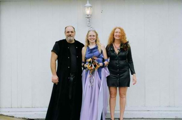 Megan with her dress designing parents, Debbie and Jason